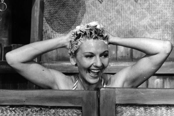 Mary Martin washes that man right out of her hair in a scene from the 'overrated' South Pacific at the Theatre Royal, Drury Lane, in 1945