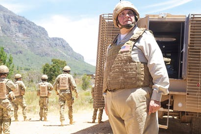 Liaison duties: Randall Carter (Michael McShane) in 'Bluestone 42'