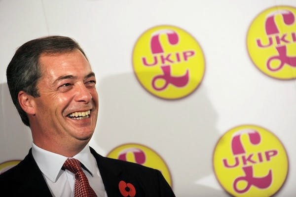 Nigel Farage reacts during a press confe