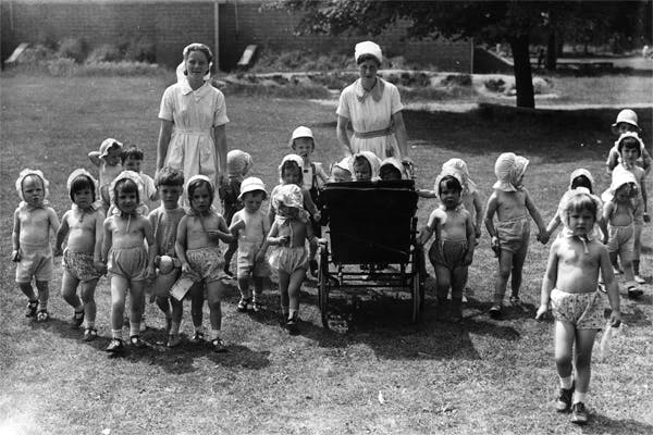 8th July 1941: A group of children whose homes have been destroyed by World War II bombing raids enjoy a walk in the English countryside to which they have been evacuated. (Photo by Fred Morley/Fox Photos/Getty Images)