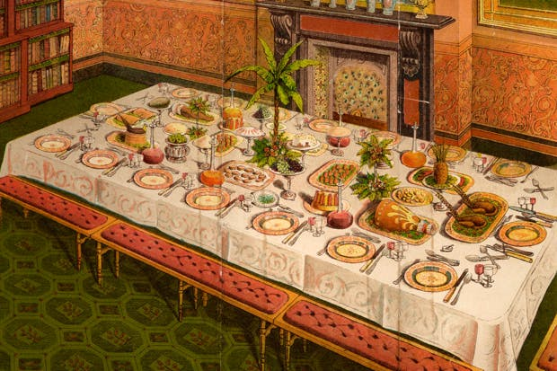 A well-laden supper table, according to Mrs Beeton, set for 16, with an exotic central floral arrangement (1861)