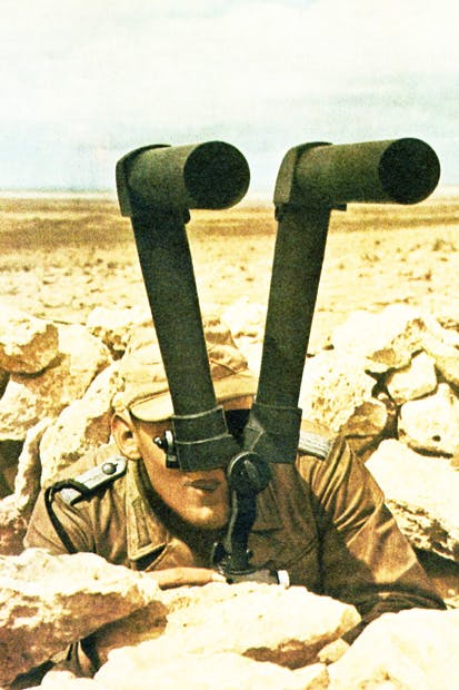 A German soldier in the Western Desert in 1942 scans the horizon for enemy movements