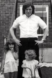 Comforting domesticity: Alan Johnson with his stepdaughter Natalie and daughter Emma