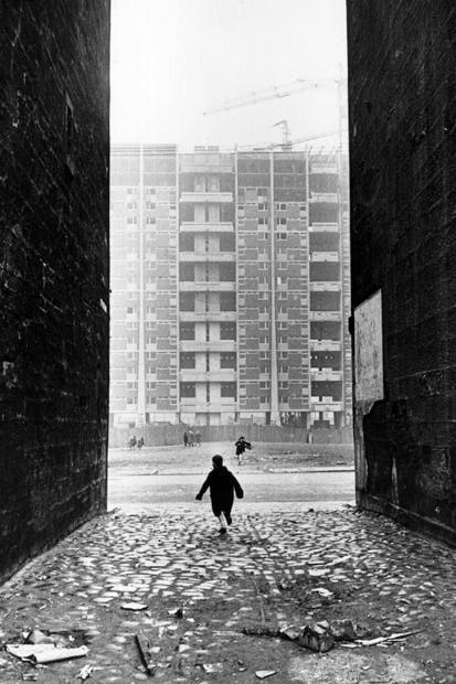 Tenements in the Gorbals area of Glasgow — considered some of the worst slums in Britain — are replaced by high-rise flats, c. 1960