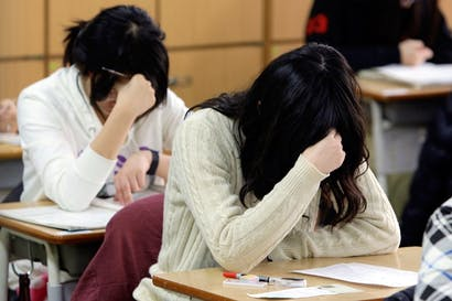 Girls sitting South Korea's famously competitive university entrance test. North London Collegiate offers IBs instead