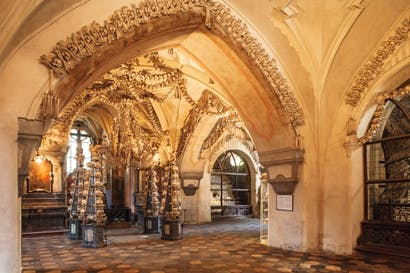 The ossuary at Sedlec in Czechoslovakia, where garlands of skulls drape the vault. The chapel is thought to contain the skeletons of up to 70,000 people