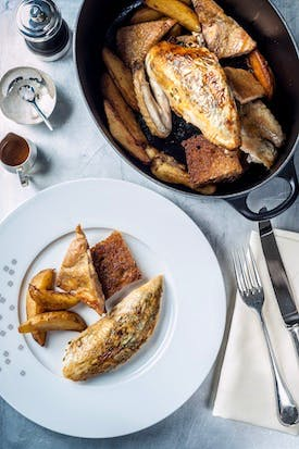 The Grill at The Dorchester - Black leg free-range chicken, 'street corner' potatoes, toasted country bread high res