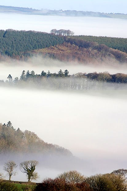Morning mist in the valleys of northeast Dartmoor, seen from the summit of Brent Tor