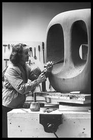 Barbara Hepworth in the Palais de la Danse studio, St Ives, at work on the wood carving 'Hollow Form with White Interior', 1963
