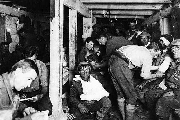 British soldiers having wounds treated in an underground dressing station by the Menin Road in France. (Photo by Frank Hurley/Three Lions/Getty Images)