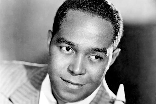 Jazz soloist Charlie Parker with his saxophone c. 1946