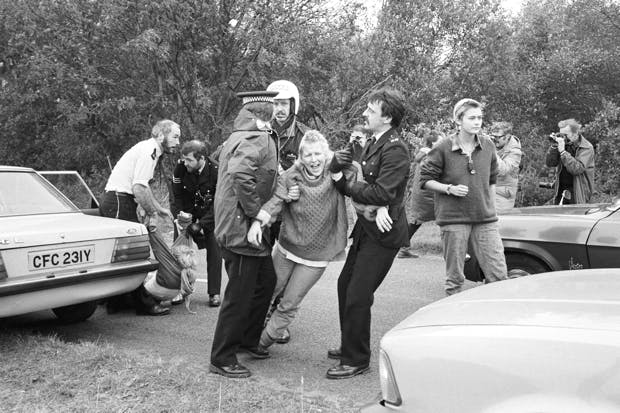 A demonstrator is arrested during an anti-nuclear protest at Greenham Common air base in 1983. (Photo: D. Jones/Express/Getty)