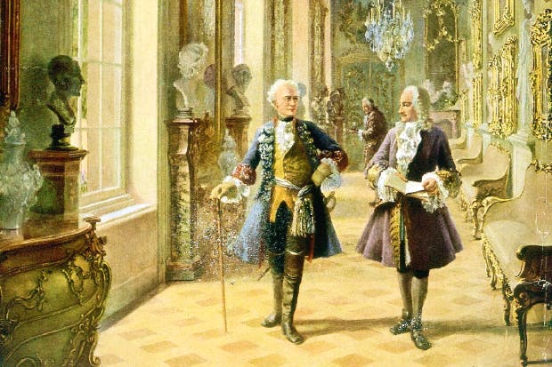 Frederick strolls with Voltaire through the palace of Sans-Souci