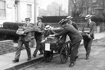 Spreading the word: boys from independent Dover College carry stacks of books through the town in 1963