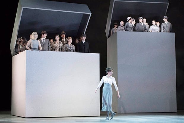 Thinking inside the box: Stéphanie d'Oustrac (Béatrice) and the chorus in 'Béatrice et Bénédict' at Glyndebourne
