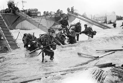 Royal Marine commandos coming ashore on Juno Beach, 9 a.m., 6 June 1944. The Allies fixed a tidally perfect day to land using a Victorian music machine