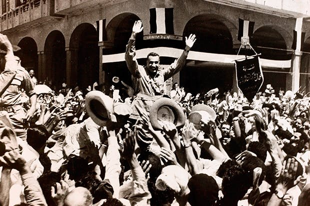 Nasser carried through the streets of Port Said after the British evacuation, 1956