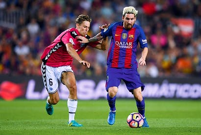 The player: Lionel Messi, with Marcos Llorente of Deportivo Alavés