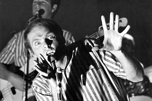 Mike Love, with Brian Wilson in the background, on TV in Los Angeles, 1962