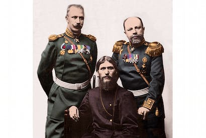 Holding court: Rasputin takes centre stage, with Captain von Lohman of the Ismailovsky Regiment (left) and Colonel Prince Putyatin, Chamberlain of the Imperial Palaces