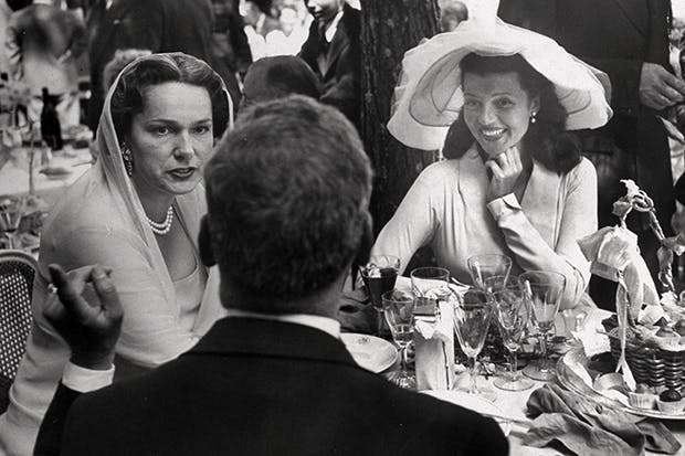 'Too much caviar, Rita, too much caviar.' The Aga Khan is seated beside his fourth wife and opposite Rita Hayworth at the reception following her wedding to his son Prince Aly Khan