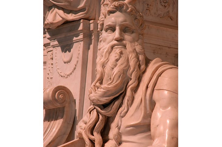 Moses has a formidable authority, with the physique of a bodybuilder and a beard that cascades like Niagara Falls