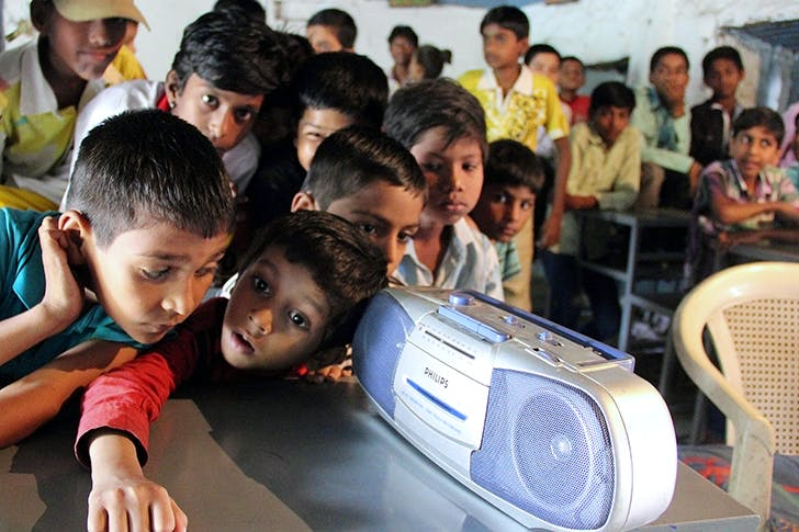 School children listen to a radio broadcast given by Indian prime minister Narendra Modi in 2014