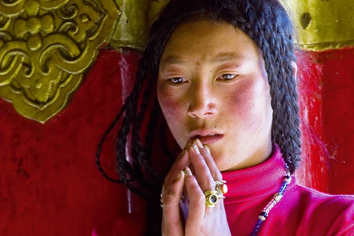A Tibetan woman prays at the Jokhang temple in Lhasa in September 2004 after one of many harsh crackdowns by the Chinese in Tibet