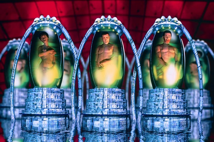A computer illustration of people in cryogenic pods