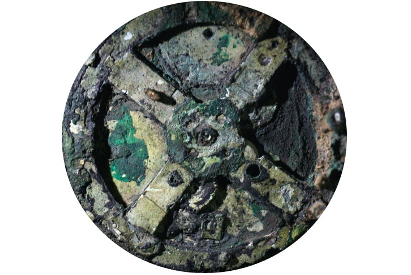 A piece of the Antikythera Mechanism, on display at the Archaeological Museum, Athens. (Getty Images)