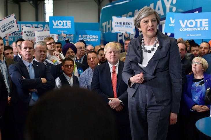 Theresa May campaigning (image: Getty)