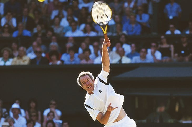 McEnroe serving in a mixed doubles match with Steffi Graf at Wimbledon, 1999