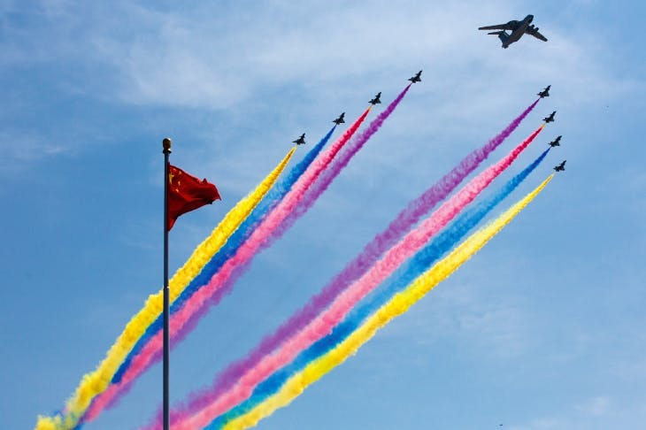 An airborne early warning system leads fighter jets during a military parade in Beijing