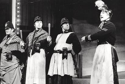 Cross-dressing in the Met. Policemen don women's clothes to catch the Whitechapel murderer. Charles West (far right) leads the search in Jack the Ripper, 1974