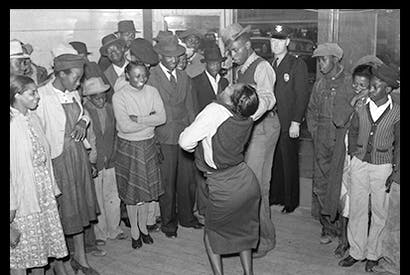 'Negroes jitterbugging in a juke joint on Saturday afternoon. Clarksdale, Mississippi Delta', November 1939, by Marion Post Wolcott