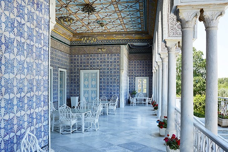 A blue-and-white loggia overlooks the entrance to the Residence in Tunis