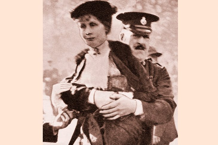 Emmeline Pankhurst is carried bodily from a demonstration outside Buckingham Palace in 1914