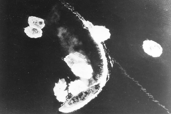 The Yamato wheels in a tight curve in an effort to avoid aerial bombardment