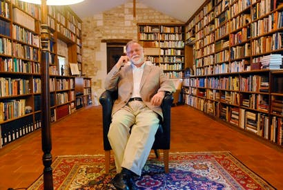 Portrait of the reader as devoted book-owner: Alberto Manguel in happier days, at home in his library in France