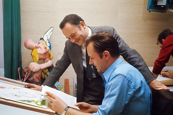 Inspired touch: Asterix creators René Goscinny and Albert Uderzo (seated) in 1967