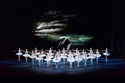 Artists of the Royal Ballet against the easel-worthy backcloths of John Macfarlane's ravishing designs for Swan Lake