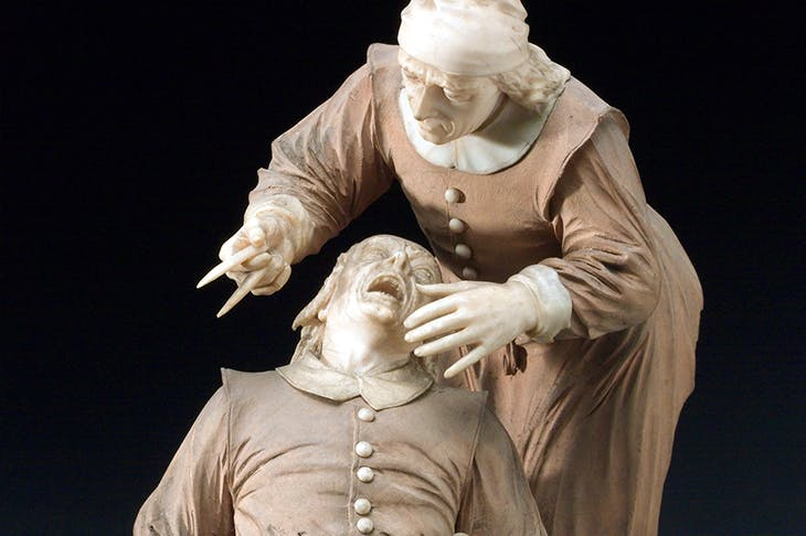 Wood and ivory figure group depicting a tooth extraction, 17th century