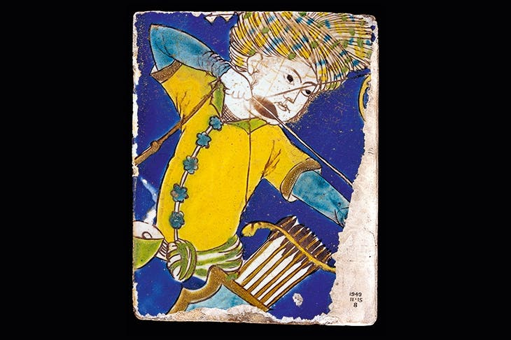 A cuerda seca tile made of stone paste, showing the figure of an archer. Safavid dynasty, early 17th century (From The History of Central Asia)