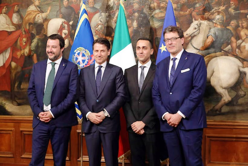 Matteo Salvini, Giuseppe Conte, Luigi Di Maio and Giancarlo Giorgetti attend the first session of the council of ministers.
