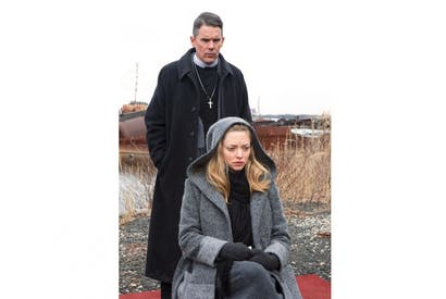 Ethan Hawke as the Revd Ernst Toller and Amanda Seyfried as Mary