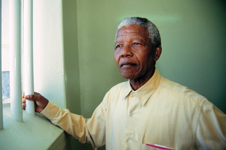 Mandela revisits his prison cell on Robben Island in 1994 [Getty]