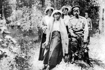 The Tsar and his daughters (from left, Maria, Anastasia and Olga) under guard in Siberia a few days before their murder