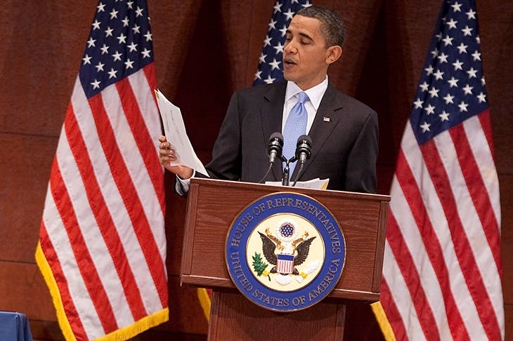 Obama reads a letter from a citizen pleading for Health Care Reform in March 2010. Credit: Getty Images.