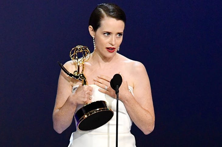 Claire Foy accepts the best actress Emmy for her role as Queen Elizabeth II in The Crown. Photo: Getty