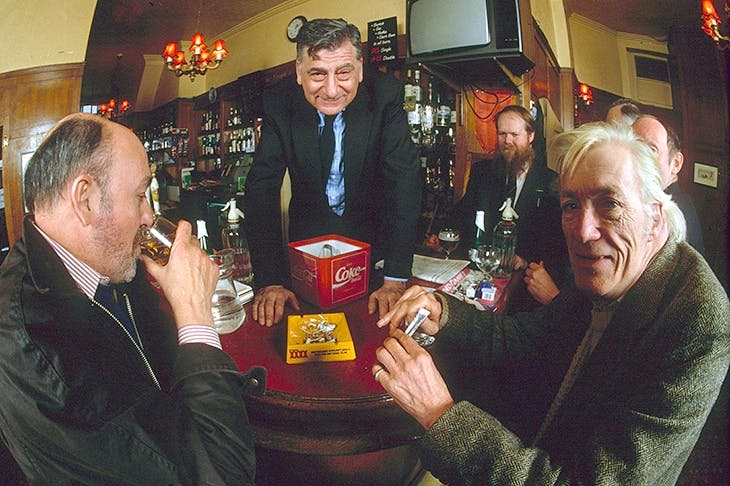 Jeffrey Bernard and Christopher Howse among drinkers at the Coach and Horses. Norman Balon presides. Credit: Rex Features